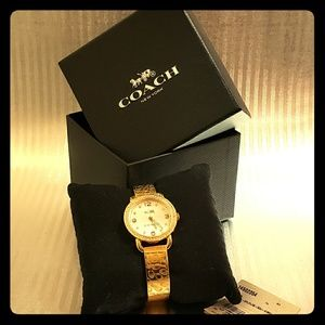 Ladies Coach Cryastl accent Gold Tone Bangle Watch